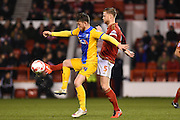 Preston striker Joe Garner  and Nottingham Forest defender Matt Mills (Capt) during the Sky Bet Championship match between Nottingham Forest and Preston North End at the City Ground, Nottingham, England on 8 March 2016. Photo by Jon Hobley.