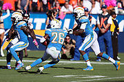 Los Angeles Chargers cornerback Casey Hayward (26) looks for running room after intercepting a fourth quarter pass at the Chargers 8 yard line stopping a potential Denver Broncos scoring drive during the 2017 NFL week 7 regular season football game against the Denver Broncos, Sunday, Oct. 22, 2017 in Carson, Calif. The Chargers won the game in a 21-0 shutout. (©Paul Anthony Spinelli)