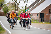 In Zegveld rijdt een groep mannen door het boerenlandschap.<br /> <br /> In Zegveld a group men cycle at the countryside.