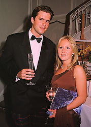 MR CARTER MURRAY and MISS ALICE BAMFORD daughter of Sir Anthony Bamford chairman of JCB, at a dinner in London on 19th May 1998.MHS 72