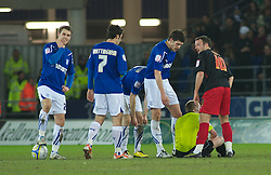 CARDIFF, WALES - Tuesday, February 1, 2011: Cardiff City and Reading players share a laugh as Referee Gavin Ward sits injured during the Football League Championship match at the Cardiff City Stadium. (Photo by Gareth Davies/Propaganda)