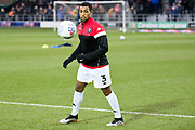 Salford City defender Ibou Touray warming up before the EFL Sky Bet League 2 match between Salford City and Macclesfield Town at the Peninsula Stadium, Salford, United Kingdom on 23 November 2019.