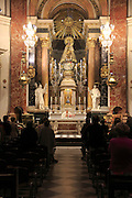 Catholic mass priest at altar in cathedral church, city of Valencia, Spain