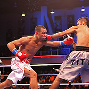Marvin Quintero (L) and Miguel Vazquez fight for the IBF Lightweight title during the HBO Triple Explosion fight at the Turning Stone Resort Casino in Verona, NY, on Saturday, Oct 27, 2012. (AP Photo/Alex Menendez)
