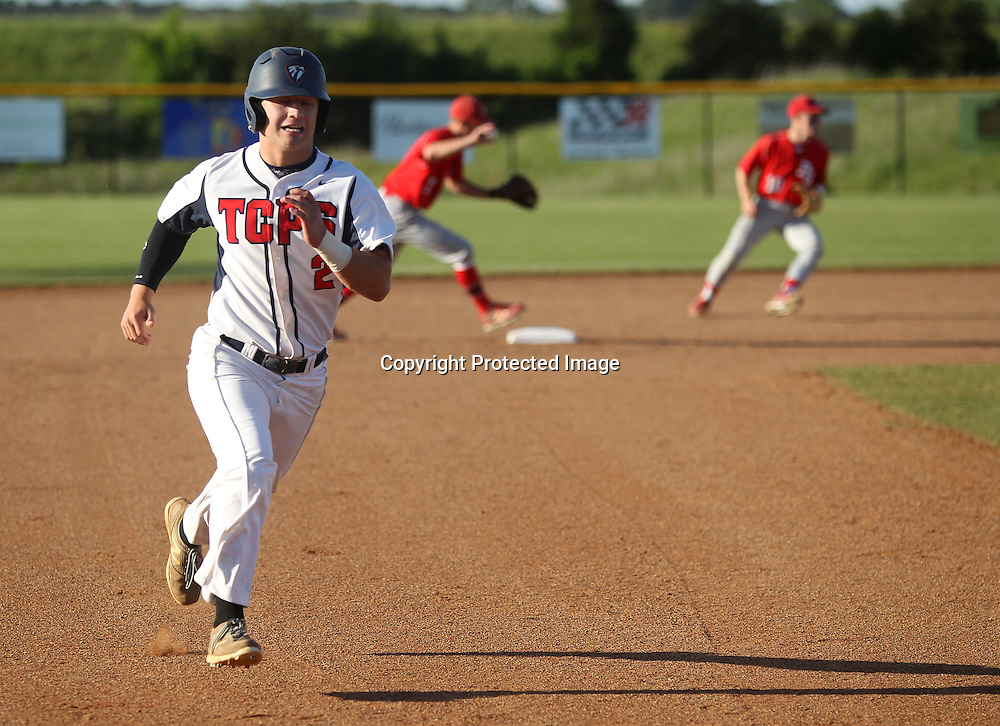 Adam Robison | BUT AT PHOTOS.DJOURNAL.COM<br /> John Mark Jolly races for third base in the first inning against Pine Grove.