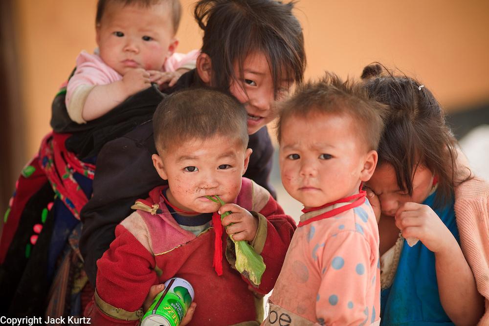 Mar. 16, 2009 -- LUANG PRABANG, LAOS: Hmong children in a town south of Luang Prabang, Laos. The Hmong are the largest ethnic minority in Laos.  Photo by Jack Kurtz