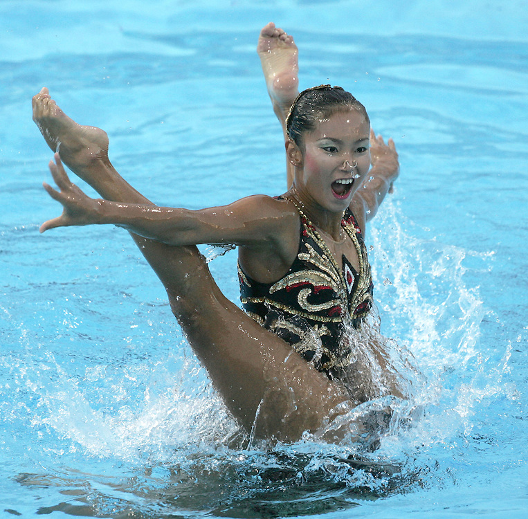 Japan's Saho Harada and Emiko Suzuki perform during the synchronized swimming-duet finals competition at the FINA World Championships in Montreal, Quebec Friday 22 July 2005. Russia won the gold, Spain won the silver and Japan won the bronze.