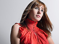 Woman in red top  in studio head and shoulders