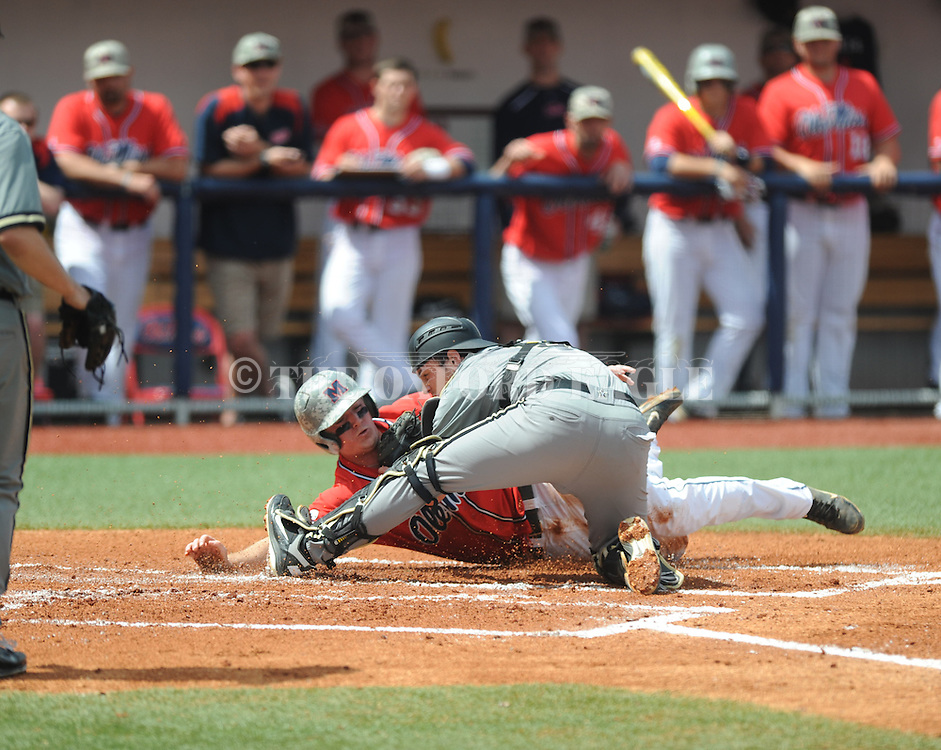 Ole Miss' Austin Anderson (8) is tagged out trying to score from second on a fly ball to center field by Vanderbilt catcher Spencer Navin (5) at Oxford-University Stadium Stadium in Oxford, Miss. on Sunday, April 7, 2013. Vanderbilt won 7-6 in 11 innings.