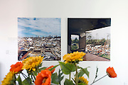 "Greensburg, Kansas, USA..inside 5.4.7 Art Center (photos on wall by Larry Schwarm)..The 5.4.7 Arts Center takes their name from the date of the tornado that devastated Greensburg on May 4, 2007. It is the first LEED Platinum building designed and constructed by students, and is the first LEED Platinum certified structure in the state of Kansas. The building earned the LEED Platinum certification through its use of wind turbines, photovoltaic panels, geothermal climate control, recycled building materials and a host of other ecologically minded features. The 5.4.7 Art Center is a community arts center to raise awareness of fine arts, both visual and performing, making arts accessible to everyone and provide an environment to create and gather knowledge through classes, exhibits and performances. ""The arts are extremely important to our community in order to maintain and cultivate our identity, our heritage, and our culture.""..""Greensburg: Better, Stronger, Greener!"".On May 4, 2007, an EF5 tornado cut a 1.7-mile path of destruction through Greensburg, Kansas. Winds reaching speeds of 205 miles per hour uprooted trees, demolished homes and leveled the town. Eleven people died and 95% of the buildings were destroyed beyond repair. Residents have since worked furiously to rebuild it in a way that is both economically and environmentally sustainable and to meet the highest environmental standards. Greensburg, whose population has dropped from about 1400 to 800 following the storm and is now growing again, is currently the greenest town in America and the first in the United States to pass a resolution to certify that all city-owned buildings earn LEED Platinum accreditation, the highest level of the LEED rating system...Foto © Stefan Falke"