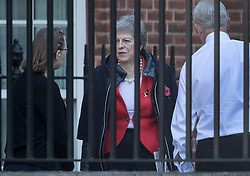 © Licensed to London News Pictures. 29/10/2018. London, UK. Prime Minister Theresa May talks to staff members as she arrives at the back of Downing Street. Later today the Chancellor will deliver his Autumn Budget to Parliament. Photo credit: Peter Macdiarmid/LNP