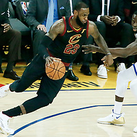 OAKLAND, CA - MAY 31: LeBron James #23 of the Cleveland Cavaliers drives past Draymond Green #23 of the Golden State Warriors in Game One of the 2018 NBA Finals won 124-114 in OT by the Golden State Warriors over the Cleveland Cavaliers at the Oracle Arena on May 31, 2018 in Oakland, California. NOTE TO USER: User expressly acknowledges and agrees that, by downloading and or using this photograph, User is consenting to the terms and conditions of the Getty Images License Agreement. Mandatory Copyright Notice: Copyright 2018 NBAE (Photo by Chris Elise/NBAE via Getty Images)