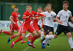 NEWPORT, WALES - Monday, October 14, 2019: Wales' Lewis Collins (L) and Austria's captain David Affengruber during an Under-19's International Friendly match between Wales and Austria at Dragon Park. (Pic by David Rawcliffe/Propaganda)
