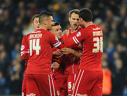 Cardiff City celebrate after Reading's Alex Pearce's own goal - Photo mandatory by-line: Dougie Allward/JMP - Mobile: 07966 386802 - 21/11/2014 - Sport - Football - Cardiff - Cardiff City Stadium - Cardiff City v Reading - Sky Bet Championship