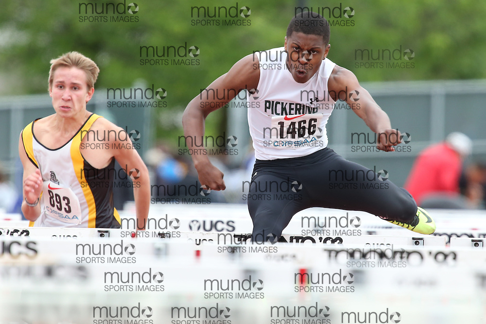 Treshaun Abrahams-Webster of Pickering HS - Ajax competes in the sprint hurdle heats at the 2013 OFSAA Track and Field Championship in Oshawa Ontario, Thursday,  June 6, 2013.<br /> Mundo Sport Images / Sean Burges