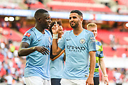 Manchester City Midfielder Riyad Mahrez (26) and Manchester City Defender Benjamin Mendy (22) celebrate winning the Community Shield during the FA Community Shield match between Chelsea and Manchester City at Wembley Stadium, London, England on 5 August 2018. Picture by Stephen Wright.