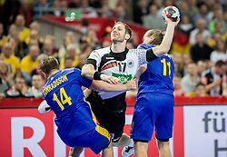 Steffen Weinhold of Germany between Jesper Konradsson of Sweden and Lukas Nilsson of Sweden during handball match between National teams of Germany and Sweden on Day 4 in Preliminary Round of Men's EHF EURO 2016, on January 18, 2016 in Centennial Hall, Wroclaw, Poland. Photo by Vid Ponikvar / Sportida