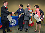 L-R: Houston ISD chief academic officer Andrew Houlihan, Director General Louis M. Huang of the Taipei Economic and Cultural Office in Houston, trustee Greg Meyers and Sophie Chou shake hands after signing a partnership agreement during a ceremony, December 17, 2015.