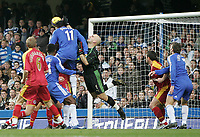 Photo: Lee Earle.<br /> Chelsea v Reading. The Barclays Premiership. 26/12/2006. Chelsea's Didier Drogba (11) rises to head their opening goal past Reading keeper Marcus Hahnemann.