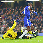 Troy Deeney tackling Ramires during the The FA Cup match between Chelsea and Watford at Stamford Bridge, London, England on 4 January 2015. Photo by Matthew Redman.