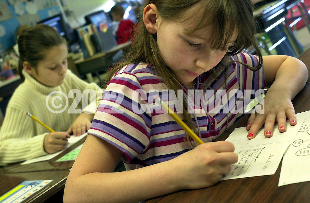 WARMINSTER, PA - APRIL 2: Justine Bitters (R), and Kayla Davis (L), write cards to be placed into folders at the Military Post Office established at Longstreth Elementary School for military members involved in the U.S.-led war with Iraq, April 2, 2003, in Warminster, Pennsylvania. The cards will be taken home to the students parents to be sent to the military family members through the USO. One third of the student population of Longstreth Elementary School has a family member in a U.S. military service stationed at the Willow Grove Naval Air Station, in Horsham, Pennsylvania. (Photo by William Thomas Cain/Getty Images)
