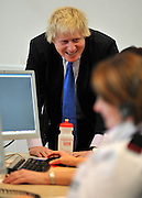 © Licensed to London News Pictures. 01/02/2012, London, UK. BORIS JOHNSON talks to a member of control room staff. Mayor of London Boris Johnson and Fire Minister Bob Neill, MP open the centre. The opening of a state of the art new fire control centre ahead of the London 2012 Olympic and Paralympic Games. The London Operations Centre (LOC) brings together in a secure, bomb proof building London Fire Brigade's control centre, London's emergency planning teams and by April the National Co-ordination Centre.Photo credit : Stephen Simpson/LNP