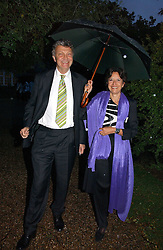 The HON.WILLIAM & HON.MRS SHAWCROSS, she is the daughter of Lord Forte at the annual Chelsea Flower Show dinner hosted by jewellers Cartier at the Chelsea Pysic Garden, London on 22nd May 2006.<br />
