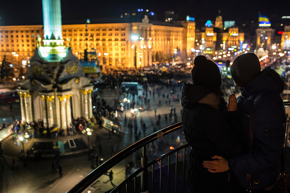 KIEV, UKRAINE - DECEMBER 3: Julia Rudchenko, 21, and Vadik Kanashuk, 19 (R), look over anti-government protests in Independence Square on December 3, 2013 in Kiev, Ukraine. Thousands of people have been protesting against the government since a decision by Ukrainian president Viktor Yanukovych to suspend a trade and partnership agreement with the European Union in favor of incentives from Russia. (Photo by Brendan Hoffman/Getty Images) *** Local Caption *** Julia Rudchenko;Vadik Kanashuk
