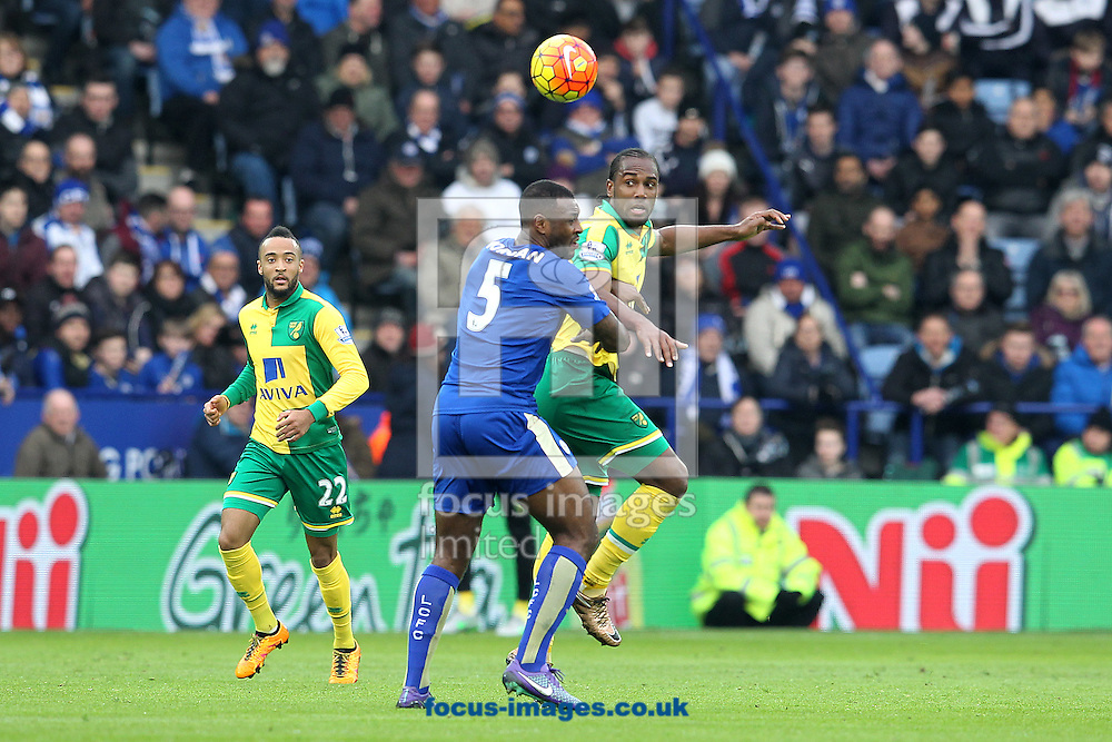 Cameron Jerome of Norwich and Wes Morgan of Leicester City in action during the Barclays Premier League match at the King Power Stadium, Leicester<br /> Picture by Paul Chesterton/Focus Images Ltd +44 7904 640267<br /> 27/02/2016