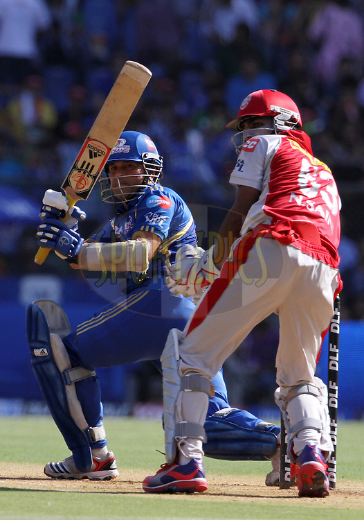 Mumbai Indian player Sachin Tendulkar plays a shot during match 28 of the Indian Premier League ( IPL) 2012  between The Mumbai Indians and the Kings X1 Punjab held at the Wankhede Stadium in Mumbai on the 22nd April 2012..Photo by: Vipin Pawar/IPL/SPORTZPICS
