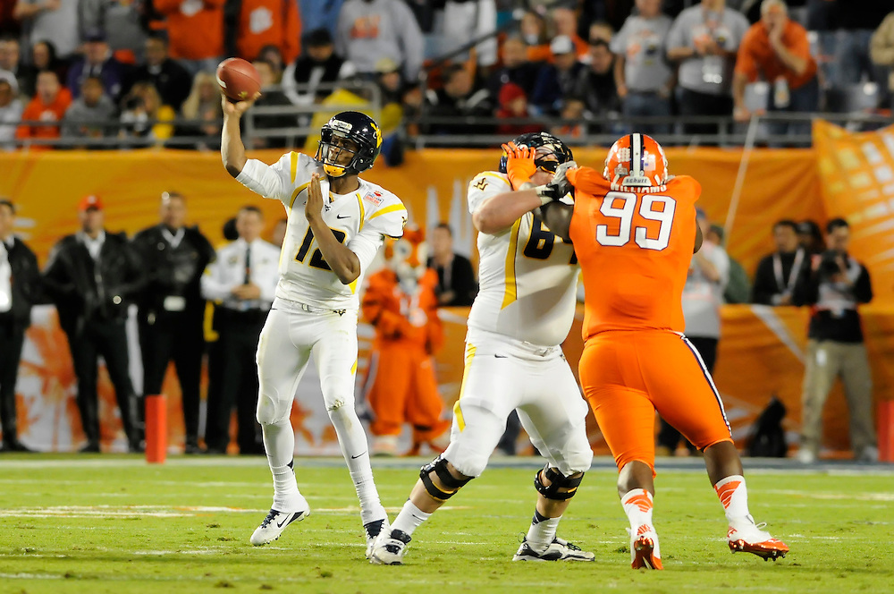 January 4, 2012: Geno Smith #12 of West Virginia drops back to pass during the NCAA football game between the West Virginia Mountaineers and the Clemson Tigers at the 2012 Discover Orange Bowl at Sun Life Stadium in Miami Gardens, Florida.