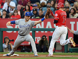 June 6, 2018 - Anaheim, CA, U.S. - ANAHEIM, CA - JUNE 06: Kansas City Royals first baseman Hunter Dozier (17) stretches and catches the ball for an out at first base on Los Angeles Angels runner Zack Cozart (7) in the first inning of a game played on June 6, 2018 at Angel Stadium of Anaheim in Anaheim, CA. (Photo by John Cordes/Icon Sportswire) (Credit Image: © John Cordes/Icon SMI via ZUMA Press)