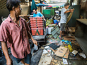04 JANUARY 2016 - BANGKOK, THAILAND:             Vendors and workers move their belongings out of Bang Chak Market after it closed Monday. The market closed January 4, 2016. The Bang Chak Market serves the community around Sois 91-97 on Sukhumvit Road in the Bangkok suburbs. About half of the market has been torn down. Bangkok city authorities put up notices in late November that the market would be closed by January 1, 2016 and redevelopment would start shortly after that. Market vendors said condominiums are being built on the land.        PHOTO BY JACK KURTZ