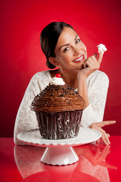 Model Shannon Quinn with a giant cupcake for the cover of the February 2013 issue of St. Louis Magazine. Photograph by St. Louis Photographer Jonathan Gayman.