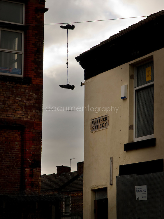 Football shoes hang on an electric cable in one of Anfield deserted street...OLYMPUS DIGITAL CAMERA