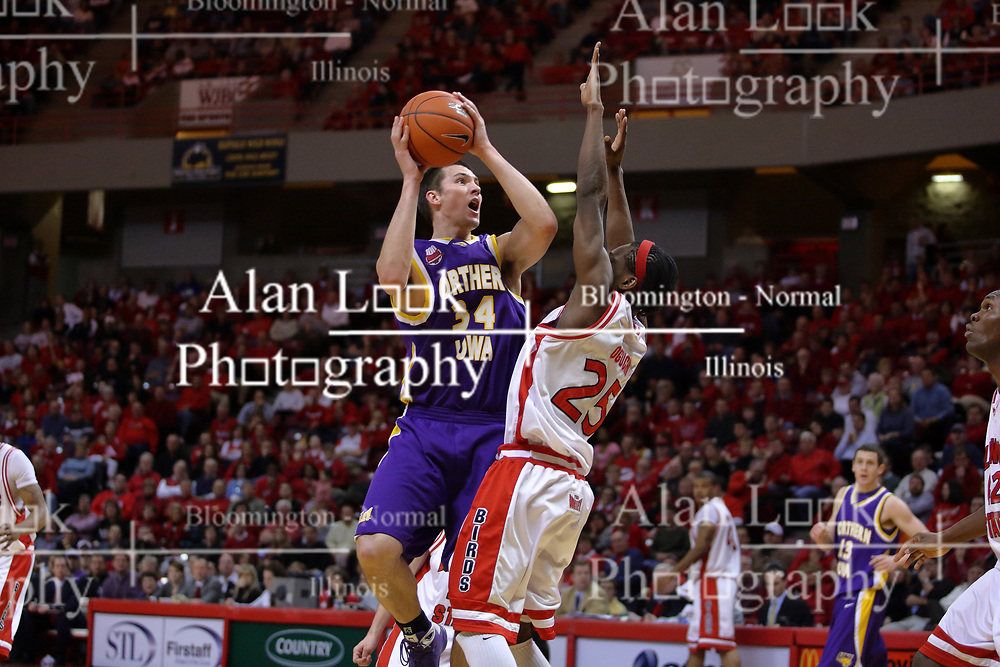 24 February 2009: Adam Koch looks for a shot over defender Champ Oguchi. The Redbirds of Illinois State University lost the Panthers of Northern Iowa in double overtime by a score of 69-67 on Doug Collins Court inside Redbird Arena on the campus of Illinois State University in Normal Illinois