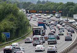 © Licensed to London News Pictures; 31/07/2020; Portbury, North Somerset, UK. Heavy traffic queues on the M5 motorway southbound on the hottest day of the year so far. There have been severe delays on the M5 southbound between Thornbury and Clevedon as people head to the southwest for the weekend during the coronavirus Covid-19 pandemic. The South West's coronavirus R number is the joint highest in the country, according to the latest Government data. The southwest of England region's R rate, which is the measure of how many new people are infected by each Covid-19 case, was between 0.7 and 1.0 last week. But the range has risen to between 0.8 and 1.1, in figures released today, July 31. The South West is one of only two regions in the country with an upper 'R rate range' of 1.1, along with the North West where the Government imposed lockdown restrictions late last night amid fears of a second wave of coronavirus. Photo credit: Simon Chapman/LNP.