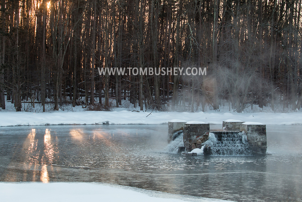 Middletown,  New York - Steam rises from the water at Monhagen Reservoir in on a  cold morning. The temperature was  close to zero.