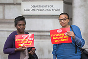 Joan May and Loretta Morris, Department for Digital, Culture, Media & Sport. (DCMS) 100 Parliament Street. PCS members working in the civil service are holding a short, high profile protest to demonstrate about the continued 1% pay cap public sector pay cap that has been in place for 7 years.Westminster,  London,  United Kingdom. (Photo by Andy Aitchison / PCS)