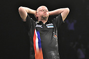 Raymond van Barneveld misses a high checkout during the Betway Premier League Darts at the Manchester Arena, Manchester, United Kingdom on 23 March 2017. Photo by Mark Pollitt.