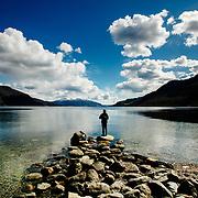 A man is seen fishing at Ølsfjorden, near the town of Ølen in Norway