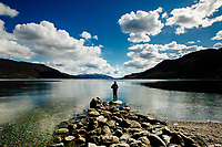 A man is seen fishing at Ølsfjorden, near the town of Ølen in Norway