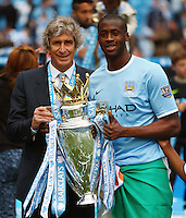 Manuel Pellegrini the head coach / manager of Manchester City and Yaya Toure of Manchester City with the Barclays Premier League trophy