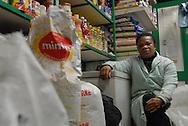 Roma (Italy), 09/02/2007: Confort, nigeriana, al suo banco di prodotti alimentari, Mercato Esquilino - Confort, from Nigeria, at her food stall, Esquilino market.
