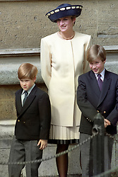 "Embargoed to 0001 Monday August 21 File photo dated 19/4/1992 of Diana, Princess of Wales with her sons, Prince William, right, and Prince Harry outside St George's Chapel in Windsor Castle. Diana, Princess of Wales was a woman whose warmth, compassion and empathy for those she met earned her the description the ""people's princess""."