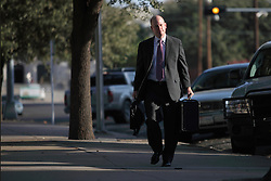 "Assistant Texas Attorney General Eric Nichols walks into the courthouse to finish the sentencing phase for Warren Jeffs, leader of the Fundamentalist Church of Jesus Christ of Latter Day Saints, San Angelo, Texas, Aug. 9, 2011. Jeffs  was sentenced to life in prison for sexually assaulting two underage girls he claimed as ""spiritual"" brides. The Texas jury of ten women and two men deliberated for less than an hour before giving him a life sentence for one charge and 20 years for a second, the maximum sentence for both."