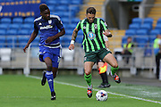 Sammy Ameobi and Callum Kennedy of AFC Wimbledon during the Capital One Cup match between Cardiff City and AFC Wimbledon at the Cardiff City Stadium, Cardiff, Wales on 11 August 2015. Photo by Stuart Butcher.