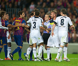 BARCELONA, SPAIN - Tuesday, April 24, 2012: Chelsea's captain Frank Lampard is pulled away by Raul Meireles after kicking FC Barcelona's Cesc Fabregas during the UEFA Champions League Semi-Final 2nd Leg match at the Camp Nou. (Pic by David Rawcliffe/Propaganda)
