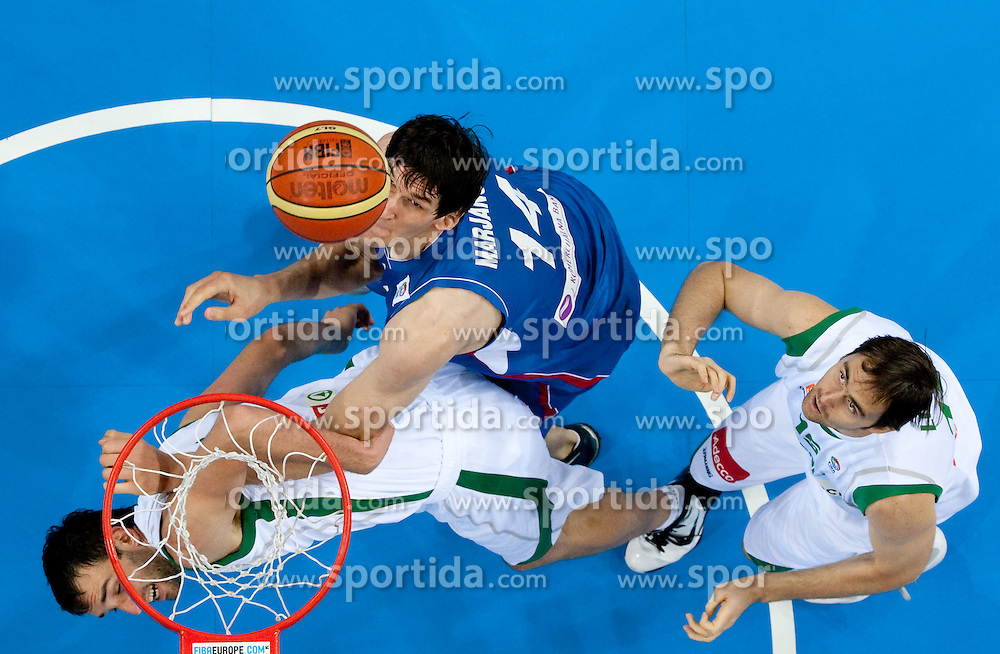 Boban Marjanovic of Serbia between Mirza Begic of Slovenia and Erazem Lorbek of Slovenia during basketball game between National basketball teams of Slovenia and Serbia in 7th place game of FIBA Europe Eurobasket Lithuania 2011, on September 17, 2011, in Arena Zalgirio, Kaunas, Lithuania. Slovenia defeated Serbia 72 - 68 and placed 7th. (Photo by Vid Ponikvar / Sportida)