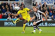 Burton Albion striker Lucas Akins (10) and Newcastle United midfielder Matt Ritchie (11) during the EFL Sky Bet Championship match between Newcastle United and Burton Albion at St. James's Park, Newcastle, England on 5 April 2017. Photo by Richard Holmes.